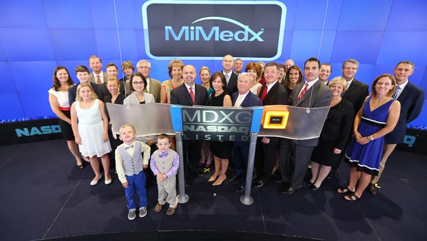 MiMedx management team on floor of NASDAQ stock exchange